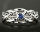 Narrow puzzle ring in sterling silver with natural sapphire