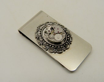 Steampunk jewelry money clip with watch movement.