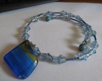 Blue neck ring glass