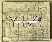 ARTWORK. Up in the Air Series. YTZ. Billy Bishop Airport Toronto. MapArt using an original 1937 Map of Toronto / Porter Q400