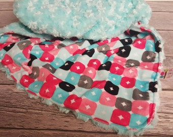 Couture minky blanket in aqua and coral shades with an Aqua minky backing