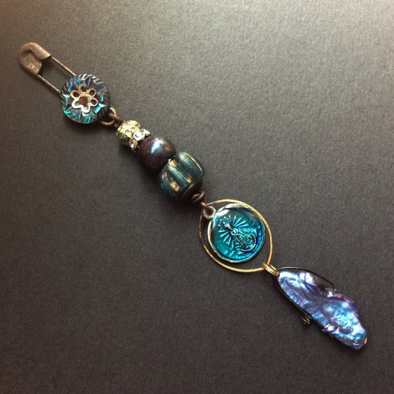 Deep Heart's Core.  Long dangle brooch in iridescent blue.