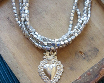 SACRED HEART Milagro Charm adorning Silver Toned Multi Strand Bracelets- Protection you need everyday