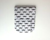 small pouch . cosmetics / accessories pouch . geek chic moustaches with black lining