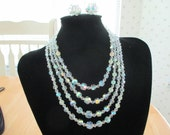 Vintage costume jewelry   / 4 strand crystal necklace and crystal clip on earrings. just reduced