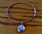 Vintage Sterling Silver Charm Bracelet with a Round Locket Charm