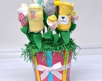 Baby Shower Gift Basket for Newborn Girl, Unique Infant Gift, Baby Clothing Bouquet made from Layette, Bodysuits, Washcloths, Bibs & More