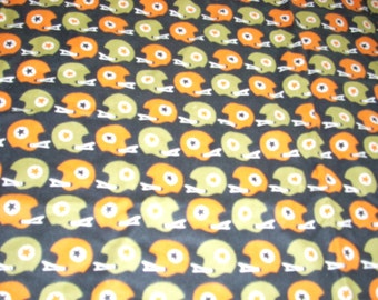 """Football helmets on black Flannel Fabric  - 43"""" wide - sold by the yard"""