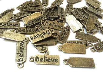 Set of 20 Believe Charms, antique bronze
