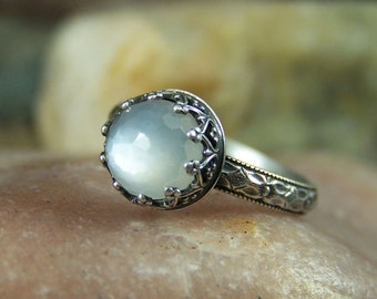 Moon Maiden - 8mm Micro Faceted Round Silky White Moonstone in Heart Crown Bezel Sterling Silver Ring