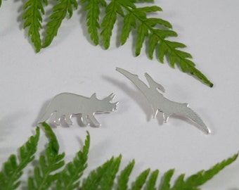 Silver Dinosaur earrings: A pair of Triceratops and Pterodactyl shaped sterling silver earrings.