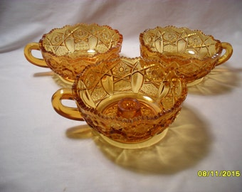 Set of 3 Matching Amber Pressed Glass Nappy Dishes 2 Dishes 1 Candle Holder