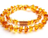 Baltic Amber Baby  Teething Necklace.  Honey coloured beads. Magnetic clasp for more security.