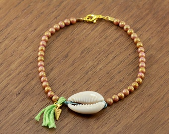 cowie shell bracelet, silk cord, chartreuse green tassel, silver plated leaf charm, boho chic