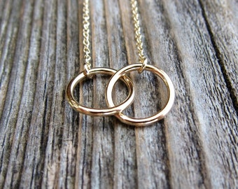 Linked circles necklace. Interlocking infinity circle necklace.