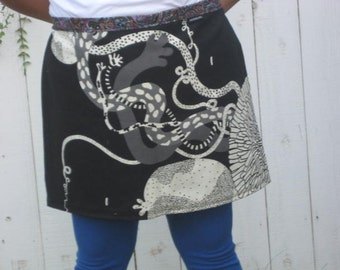 Organic shapes in black and white half apron, long ties
