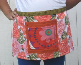Flowers in pinks and oranges, half apron with two large pockets, heavy cotton fabric.