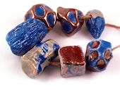 Immensity of the sea -- 7 blue and metallic ceramic beads in sea colours