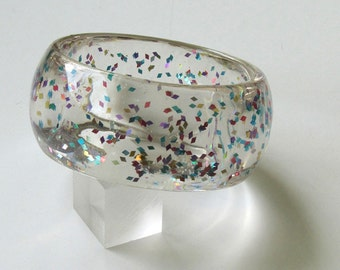 Clear resin bangle bracelet with embedded colorful  metal confetti particles