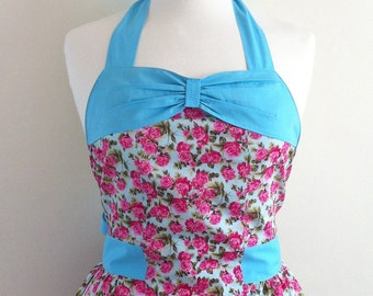 Retro apron with bow, Pink flowers on a blue fabric with a blue bow,  fully lined.