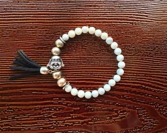 laughing buddah large white beaded bracelet