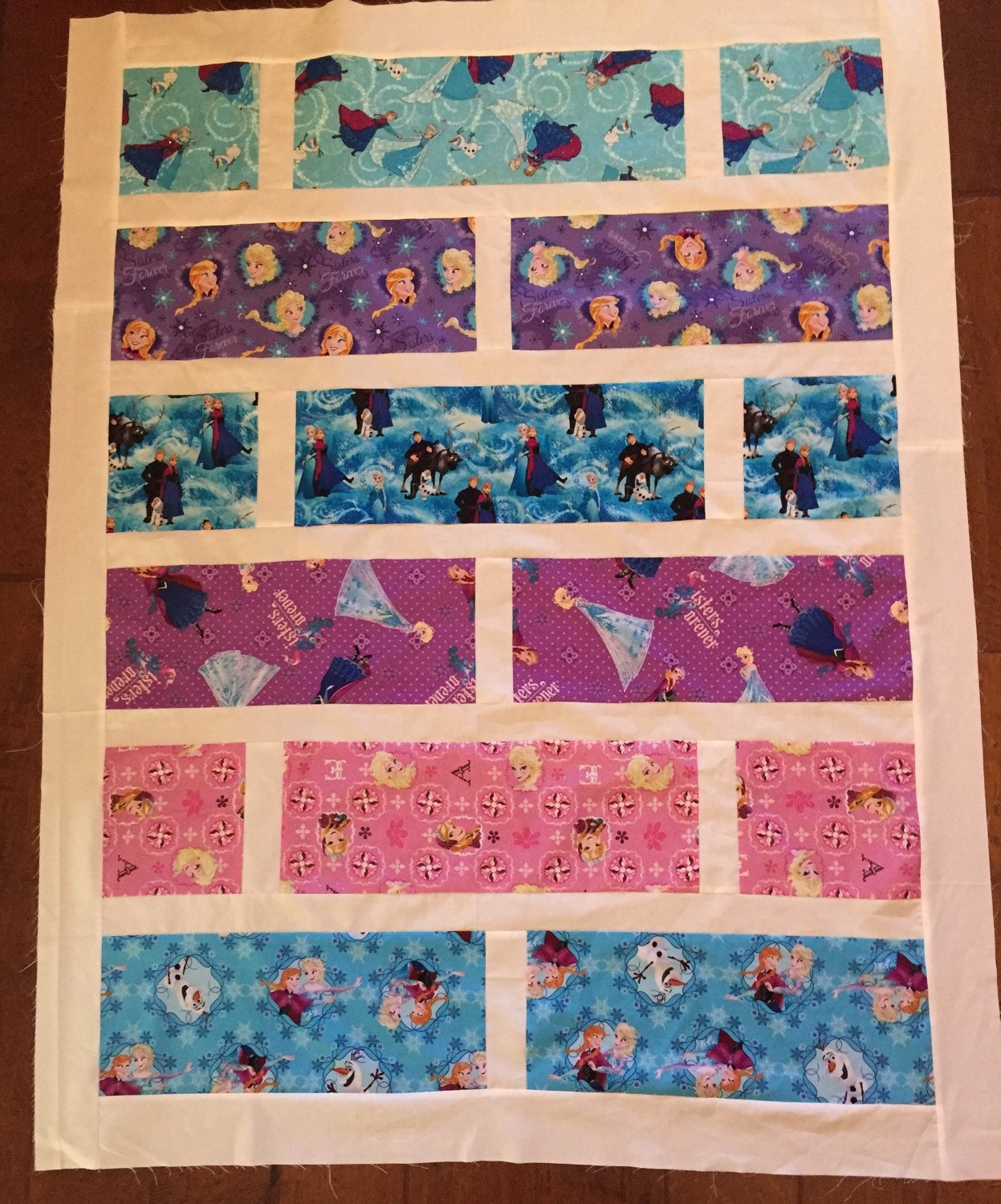 Sale disney frozen quilt kit cotton fabric from spring for Quilting fabric sale
