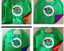 Teenage Mutant Ninja Turtls SuperHero Capes in satin with emblem, masks and cuffs in Felt