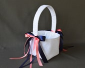 White lace wedding flower girl basket with coral pink and navy blue satin ribbon bows
