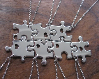Seven Silver Pendant Necklaces with Hand Cut Hearts