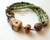 Ceramic and Lampwork Bracelet, Multi Strand Seed Beaded Bracelet with Bird House Bead, Green Bracelet, Brass Bracelet, Artisan Jewelry