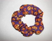 Smiling jack-o-lanterns on purple Halloween handmade Scrunchie, womans accessories, holiday accessory, gifts for her, halloween gifts, new