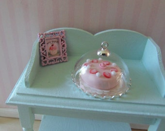 Strawberry cake with plate and dome