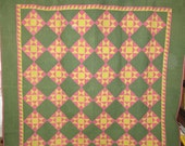 Antique Star quilt from Pennsylvania, ca.1880, pink, green, yellow; dense quilting