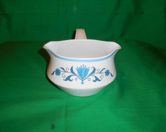 One (1), Gravy Boat with Handle, from Noritake, in the Blue Haven 9004 Pattern.
