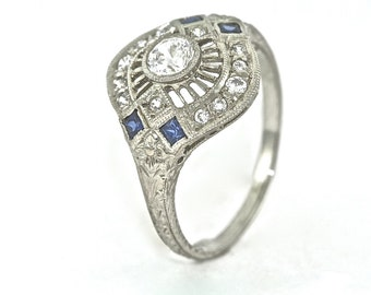 14kt White Gold Engagement Ring with Diamonds and Blue Sapphires, Hand Engraved with .25ct White Sapphire Center