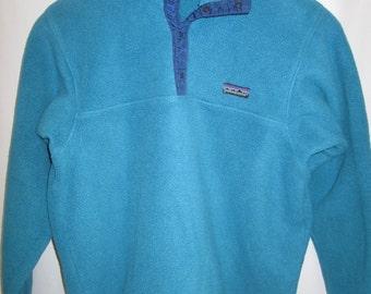 vintage, Patagonia 1st generation METAL 'T' snap turquoise green fleece purple ribbon size M