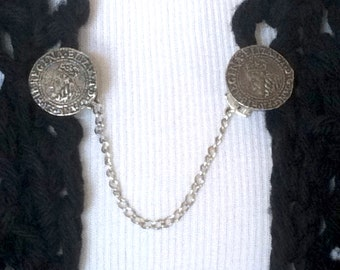 The mattie pewter Elizabethan coin sweater clip adds a touch of historical elegance to your wardrobe.