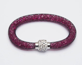 A 7 1/2 inch Black Mesh Bracelet with 3mm Pink Crystals and Magnetic Clasp.