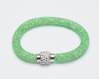 A 7 1/2 inch Green Mesh Bracelet with 3mm green Crystals and Magnetic Clasp.