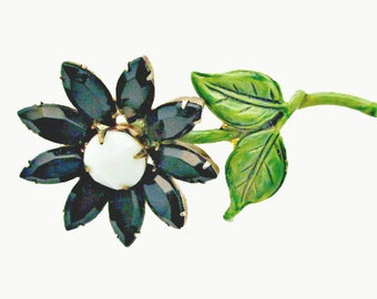 Flower Brooch with black and white glass and green enamel pin