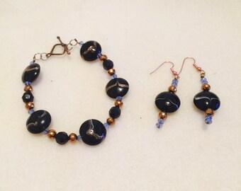 Black bracelet set with earrings.