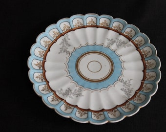 vintage unmarked baby blue & gilt plate