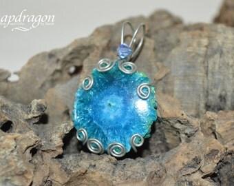 Blue solar quartz wire wrapped pendant