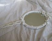 white antique hand carved wooden hand mirror