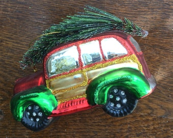 Collectible glass ornment. Vintage car with tree.
