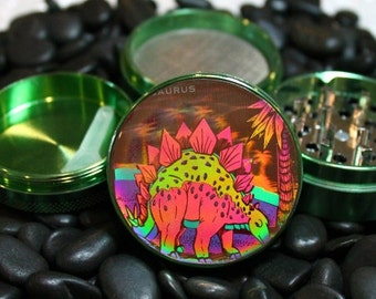 Hologram Dinosaur on a 4 piece herb grinder with plastic scraper
