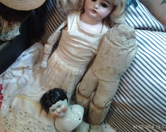 Vintage Leather Doll Body and Porcelain Head