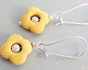 Earrings, Yellow stone quatrefoil and pearl dangle earrings.