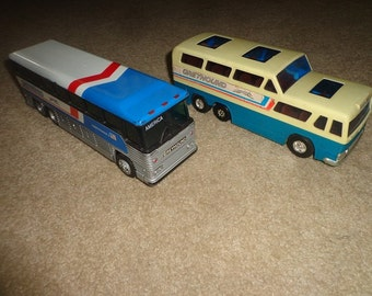 2 Greyhound buses,plastic toys late 1960s early 70s,given as passenger premium