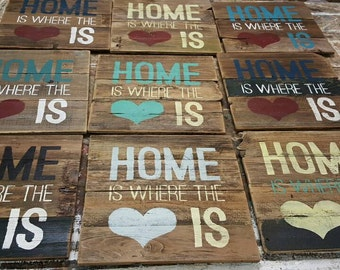 """Hand painted """"Home is where the heart is"""" sign on reclaimed wood."""